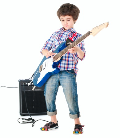 Little boy britpop style with electoguitar and guitar combo full body isolated on white photo