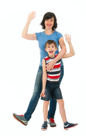 Smiling mother and son waving hands isolated on white photo