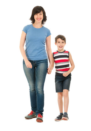 Smiling mother and son full body walking isolated on white photo