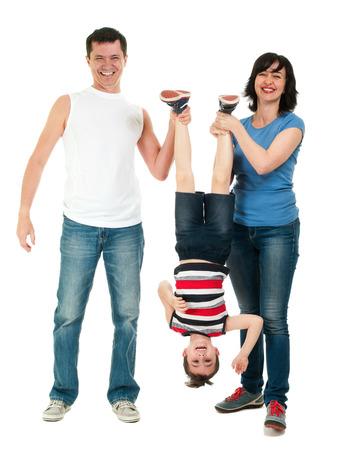 Smiling family having fun full body isolated on white photo