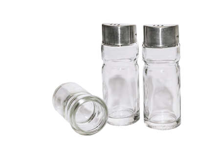 Set of glass salt and pepper shakers Isolated on a white background