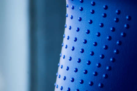 Texture of blue plastic with pimples closeup