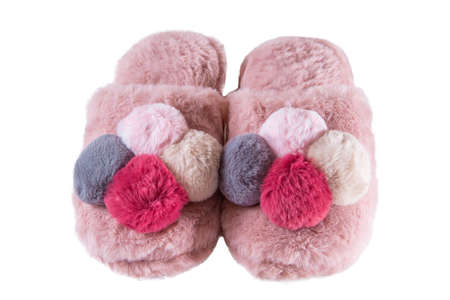 Cute home fluffy slippers with pompons isolated on white background, holiday gift