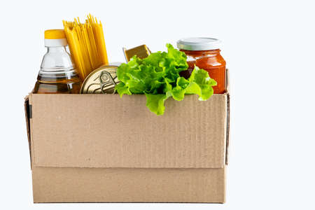 Donation box with food on a white background. Delivery of essential foodstuffs. Place for text. Standard-Bild