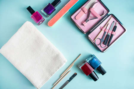 Workplace in a nail salon. A set of tools for hand care on a blue background. Place for text. Imagens