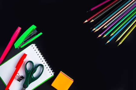 Set of stationery on a black background. Back to school concept. Place for text.