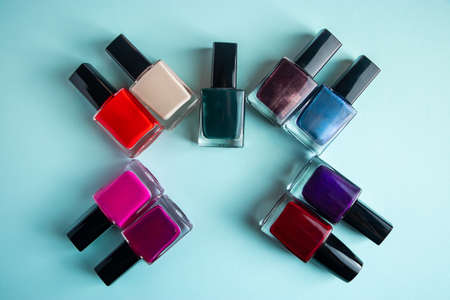 Palette of bright nail polishes on a blue background. 免版税图像