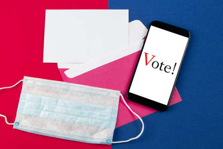 Online voting concept for elections. Phone and medical protective mask.