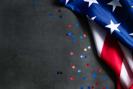 American flag and stars on a dark background. USA national holidays concept. Independence Day, Memorial Day, Labor Day. Place for your text.