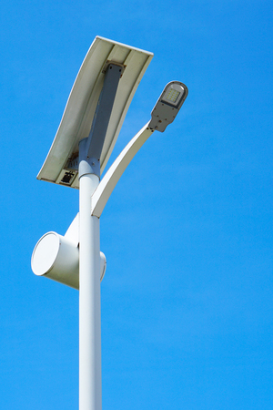 Solar energy light pole road with blue sky background.