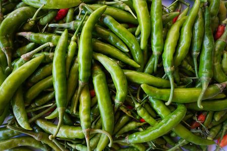 Green Chillies Background,Selective focus.Thai chillies.Organic ingredient thai food.