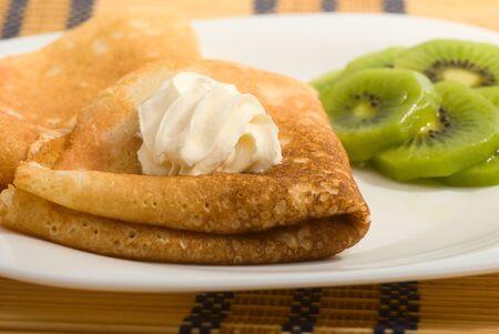 pancakes with whipped cream and kiwi fruit Stock Photo