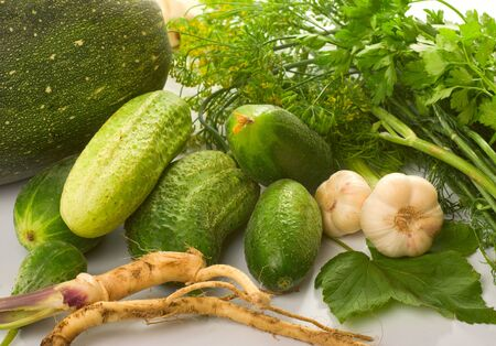 Fresh cucumbers, various vegetables, herbs and spices