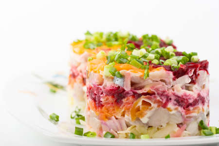 Salad with herring and vegetables on white background