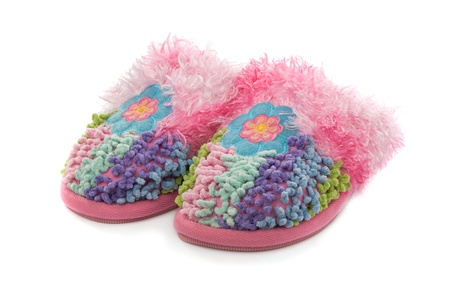 Fluffy pink slippers, isolated on a white background Stock Photo