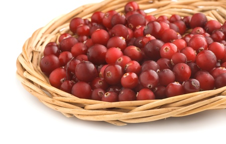 Cranberries in a wicker tray on a white background Stock Photo