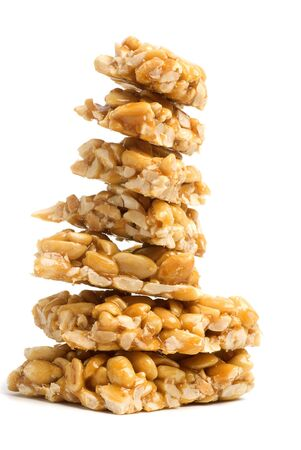 Nuts in a sweet glaze, isolated on a white background