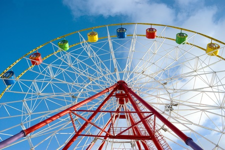 Attraction ferris wheel on blue sky background Stock Photo