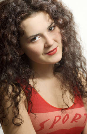 Portrait of a smiling dark-haired curly girl
