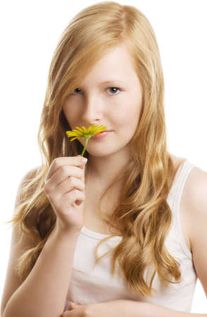 A pretty girl with a yellow flower, isolated on white background