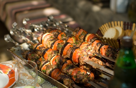 Kebab skewers with vegetables on a table close-up