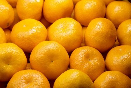 Background of fresh juicy tasty tangerines Stock Photo