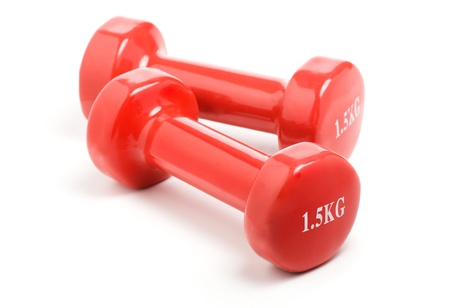 Two red dumbbells,isolated on white background
