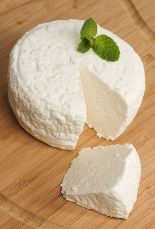 Fresh cheese, is on the board, sliced
