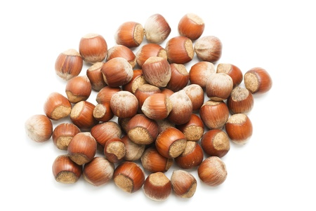 A handful of hazelnuts, isolated on white background