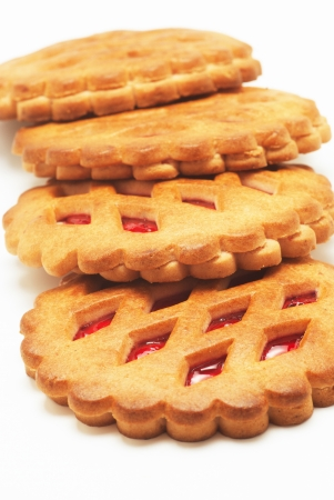 Cookies with red fruit jam close up on a white background