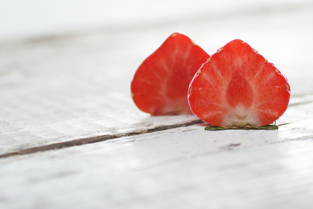 Strawberries lying on white wooden background