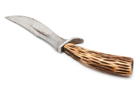 Old knife with a handle made of moose antlers, isolated on white background Stock Photo
