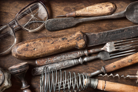 Old vintage kitchen items on a wooden background, close-up