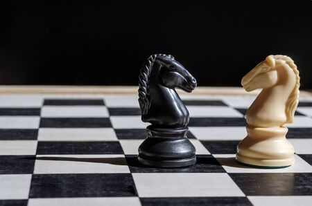 Horses, chess, checkerboard on a black background