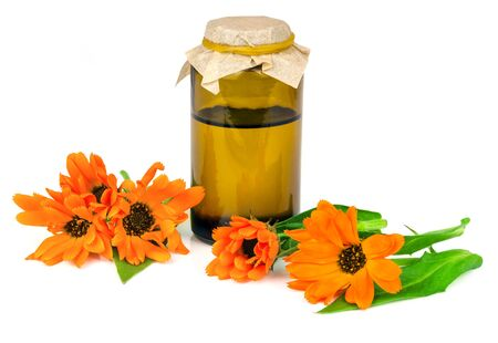 curative: Calendula  Marigold flowers with oil isolated on a white background