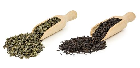 theine: green and black loose tea with a wooden shovel on a white background Stock Photo