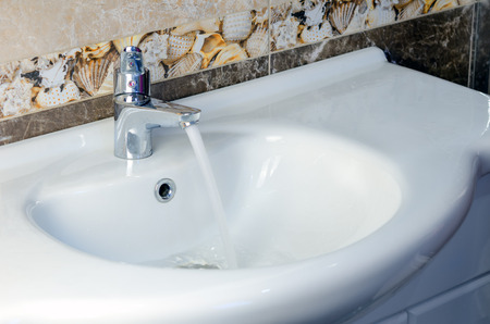 faucet water: Open faucet water in the bathroom