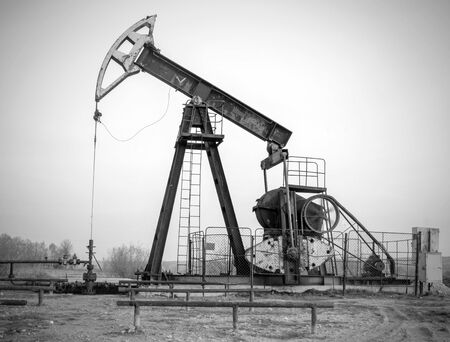 dug well: petroleum pump, black and white photography Stock Photo