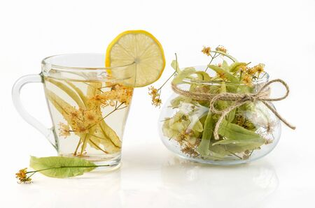 curative: herbal tea with linden and lemon on a white background
