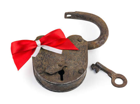 openly: old rusty lock with a red bow isolated on white background