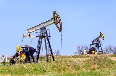 dug well: petroleum pump on a background of blue sky