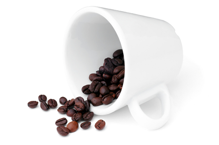 shoppe: Coffee beans spilled from a cup  Stock Photo