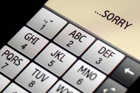SMS テキスト メッセージ申し訳ありませんが、タッチ スクリーンの携帯電話に書かれて