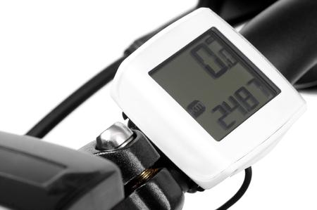 自転車のハンドルに自転車用コンピューター 写真素材