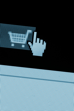 Shopping cart in the online store on a computer monitor  Stok Fotoğraf