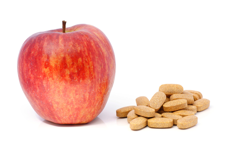 Apple and multivitamin supplement in tablet