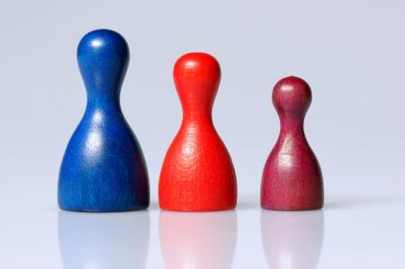 symbolization: Three wooden playing figurines