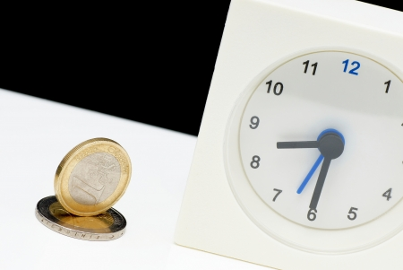 Euro money and table clock  photo