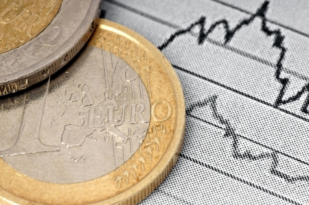 symbolization: Euro coin and chart  Stock Photo