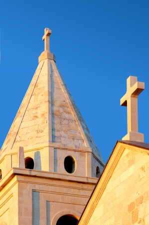 histories: Detail of the tower of the parish church- Church of St  George  St Juraj church  Primosten Croatia  Stock Photo